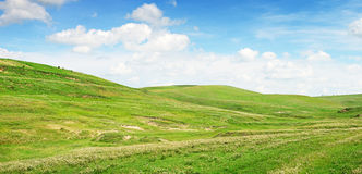 Mountainous terrain. And the blue sky Royalty Free Stock Image