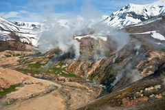 Mountainous terrain and  gas emissions in the Valley of Geysers Royalty Free Stock Images