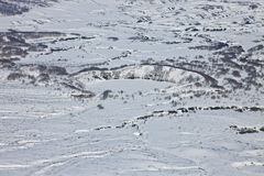 Mountainous terrain, gullies, surface erosion and Caldera volcan. O on the Kamchatka Peninsula. Neighborhood Karymsky volcano after a fresh snowfall in the Stock Images