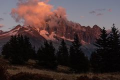 Mountainpeak illuminated by sun royalty free stock photos