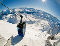 Mountains. Cable lift wagon in alps mountain peaks in sunny day stock photography