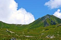 Mountains. Panoramic view on high peak and mountain ridge royalty free stock photos