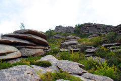 Mountains 2. Gore made ​​up of flat stone slabs, covered with grass stock photography