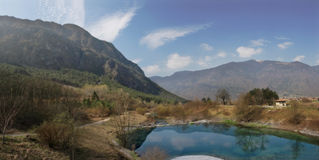 Among the Mountains. Panoramic view of small lake among mountains in Italy Stock Images