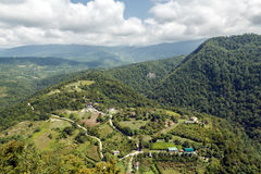 In the mountains of Abkhazia. Abkhazia. Views of surrounding area New Athos with the Iversky mountain Stock Photography