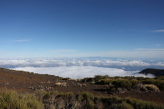 Mountains above the clouds and blue sky Royalty Free Stock Photos