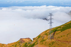 Mountains above the clouds Stock Photography