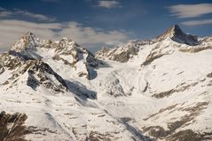 Mountains above Zermatt. In winter with blue sky Stock Photos