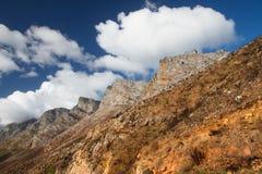 Mountains against the sky. Mountain peaks against a vivid, cloudy sky Stock Photos