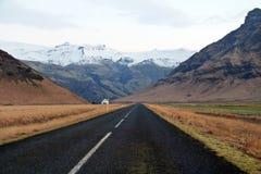 Mountains along the way. Heading to high snow white mountains Stock Photo