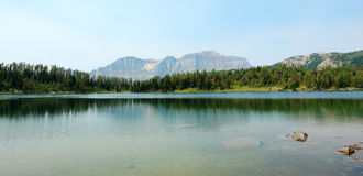 Mountains and alpine lake Stock Images