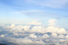 Mountains Amougst clouds. Taken above Bali Indonesia. White fluffy clouds.  Active volcanos Royalty Free Stock Photo