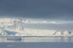 Mountains of the Antarctic Peninsula covered with stratus clouds Royalty Free Stock Photos