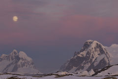 Mountains of the Antarctic Peninsula in the red sunset in the mo. Onlight Stock Photography