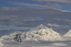 Mountains of the Antarctic Peninsula winter overcast and cloudy Stock Photo