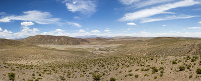 Mountains and arid landscape with blue sky in Bolivia Royalty Free Stock Photography