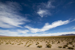 Mountains and arid landscape with blue sky in Bolivia Stock Photo