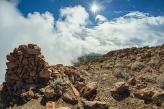 Mountains around volcano Teide, partly covered by the clouds. Bright blue sky. Teide National Park, Tenerife, Canary Islands, royalty free stock photos
