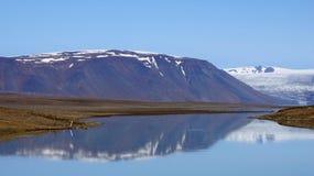 Mountains at glacier Lake Langjökull. Mountain reflection in glacier lake Hvitarvatn of the Langjökull glacier in Iceland royalty free stock photography