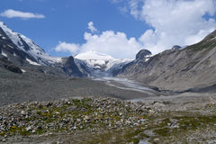 Mountains Austrian Alps Glacier Glacier Pasterze. View of the Grossglockner (3,798 m, the highest mountain in Austria - Hohe Tauern, Carinthia) at the foot of Stock Photo