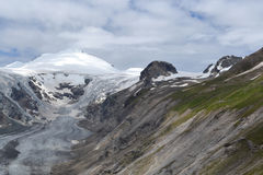 Mountains Austrian Alps Glacier Glacier Pasterze. View of the Grossglockner (3,798 m, the highest mountain in Austria - Hohe Tauern, Carinthia) at the foot of Royalty Free Stock Images