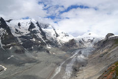 Mountains Austrian Alps Glacier Glacier Pasterze. View of the Grossglockner (3,798 m, the highest mountain in Austria - Hohe Tauern, Carinthia) at the foot of Stock Image