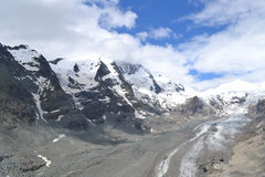 Mountains Austrian Alps Glacier Glacier Pasterze. View of the Grossglockner (3,798 m, the highest mountain in Austria - Hohe Tauern, Carinthia) at the foot of Stock Photography