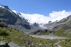 Mountains Austrian Alps Glacier Pasterze. View of the Grossglockner (3,798 m, the highest mountain in Austria - Hohe Tauern, Carinthia) at the foot of the Royalty Free Stock Photo