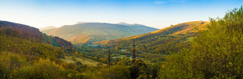 Mountains and autumn forest and blue sky panorama. Mountains and autumn forest and blue sky panorama Stock Photos