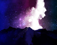 Mountains on the background of cosmic cloudy night sky Royalty Free Stock Photos
