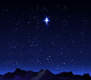Mountains in the background starry night sky with a big star Royalty Free Stock Photo