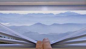 Mountains in the background window Royalty Free Stock Images