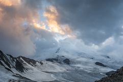 Mountains, bad weather, mountain foot, slope, glacier, Kazbek stock images