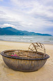 Mountains and Bamboo boat at China Beach in Danang Vietnam. Mountains and Bamboo waterproof round fishing boat at the China Beach in Danang in Vietnam. It is Royalty Free Stock Photos
