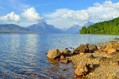 Mountains and the bank of McDonald lake in Glacier National Park Royalty Free Stock Image