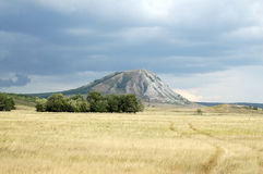 Mountains of Bashkiria. The mountain against a field and the cloudy sky Royalty Free Stock Images