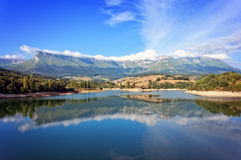 Mountains in basque country with a reservoir Stock Images