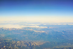 Mountains - beautiful top view from the window of plane Royalty Free Stock Photo