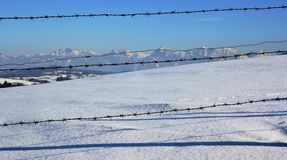 The mountains behind the fence Royalty Free Stock Photos