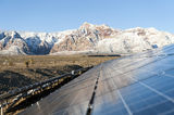 Mountains behind Solar panels Royalty Free Stock Photo