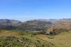 Mountains beyond Great Langdale from Loughrigg. Looking west from Loughrigg in the English Lake District, Cumbria, England to Great Langdale with Elterwater and Stock Photo