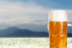 Mountains and a big glass of beer Royalty Free Stock Image