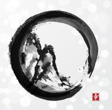 Mountains in black enso circle. Hand-drawn with ink in traditional Japanese style sumi-e on white glowing background. Contains hieroglyph - happiness Stock Photography