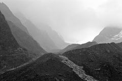 Mountains in black and white. Black and white bare mountains in a foggy landscape Royalty Free Stock Image