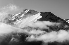 Mountains in black and white with clouds Stock Images