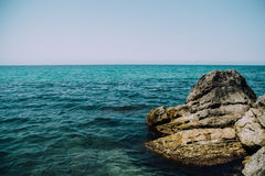 Mountains and blue sea with rocks Stock Photo