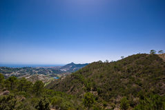 Mountains and a blue sky. The picture shows mountains and a sunny blue sky at the Costa del Sol in Spain stock image