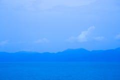 Mountains on the blue sky Stock Photo