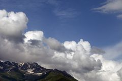 Mountains and blue sky with clouds Royalty Free Stock Images