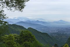 mountains overlook landscape with dujiangyan city aside Stock Image